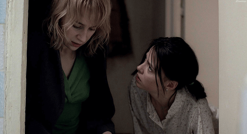 a woman consoles another woman from the film 4 luni, 3 saptamâni si 2 zile (4 Months, 3 Weeks, 2 Days)