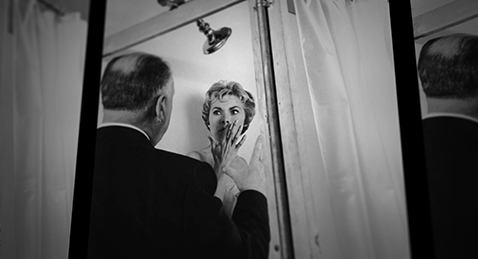 Still image of Alfred Hitchcock talking to actress Vera Miles from the film 78/52:Hitchcock's Shower Scene.