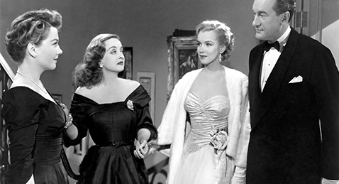 Still image of two couples in evening wear from the film All About Eve.