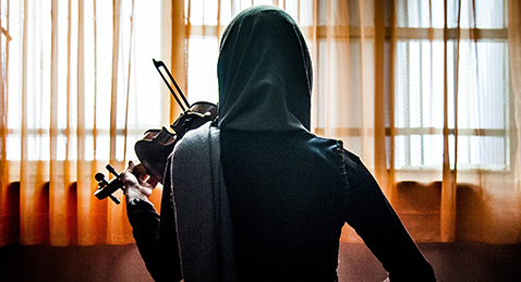 Still image of women playing Violin from the film Ava.