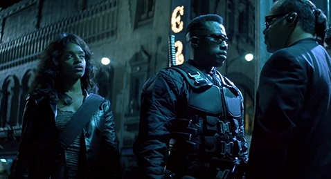 Still image of people meeting in the street from the film Blade.