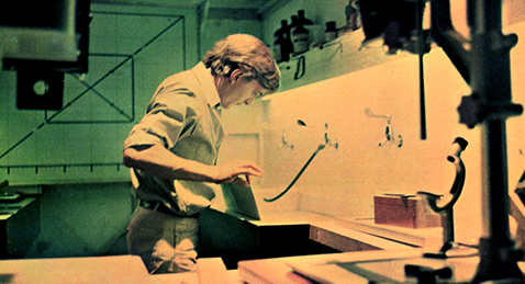 Still image of a man in a darkroom from the film Blow-Up.
