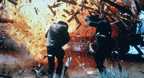 Still image of two men getting knocked back by an explosion from the film Butch Cassidy and the Sundance Kid.