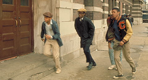 Still image of young men running in the street from the film Cooley High.