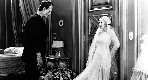 Still image of a women and Frankenstein's Monster from the film Frankenstein.