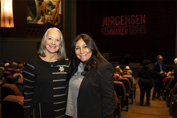Haifaa al-Mansour and Jane Jorgensen poses for a photo inside IU Cinema.