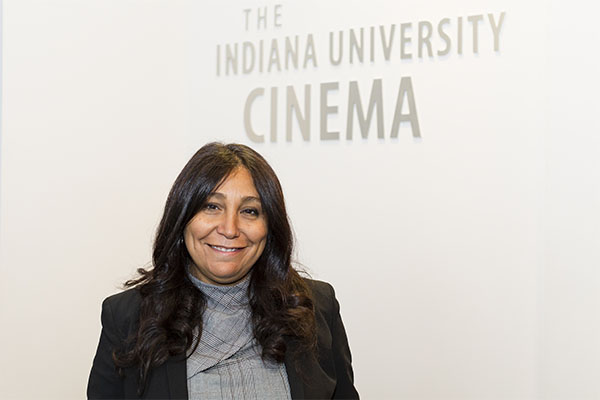 Haifaa al-Mansour poses for a photo in the lobby of IU Cinema.