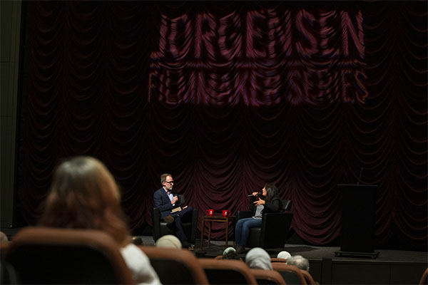 Haifaa al-Mansour and Founding Director Jon Vickers on stage at IU Cinema during her Jorgensen Guest Filmmaker event.