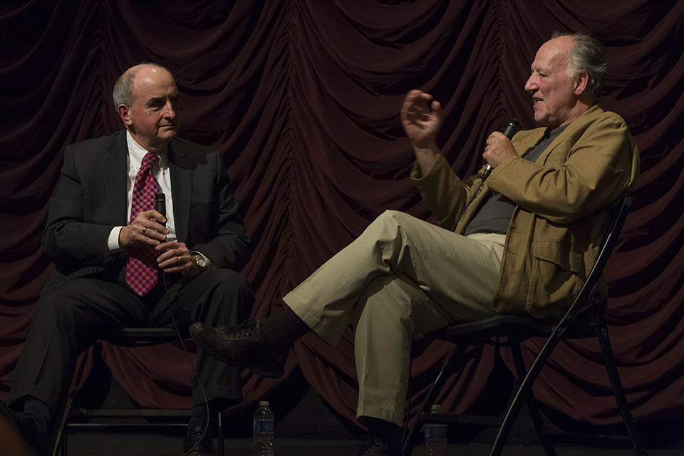 Werner Herzog on stage at IU Cinema with Indiana University president Michael McRobbie.