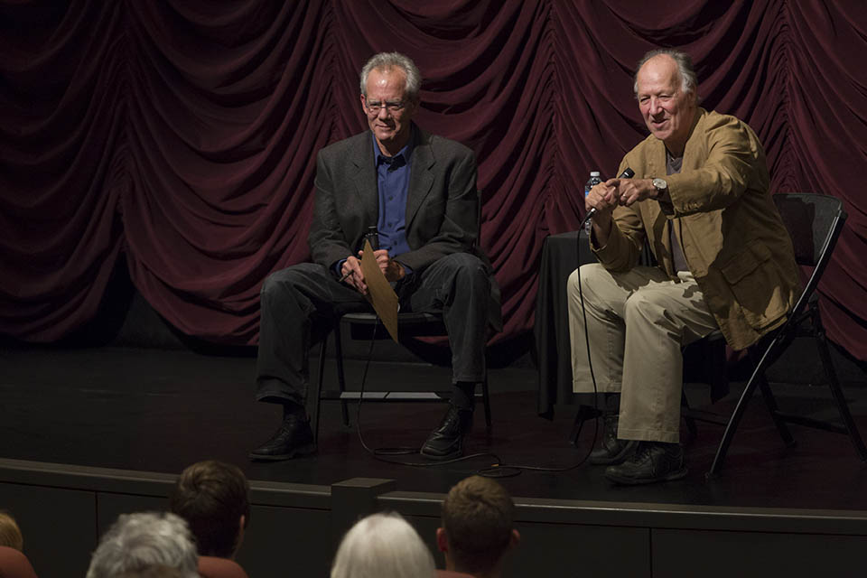 Werner Herzog on stage at IU Cinema with Indiana University faculty.