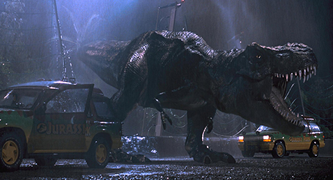 Still image of a Tyrantisaurus Rex roaring  in the dark from the film Jurassic Park.