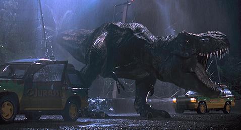 Still image of a Tyrantisaurus Rex roaring  in the dark from the film Jurassic Park.