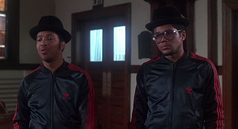 Still image or two men in track suits and hats from the film Krush Groove.
