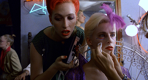 still Image of people putting on makeup from the film Liquid Sky.