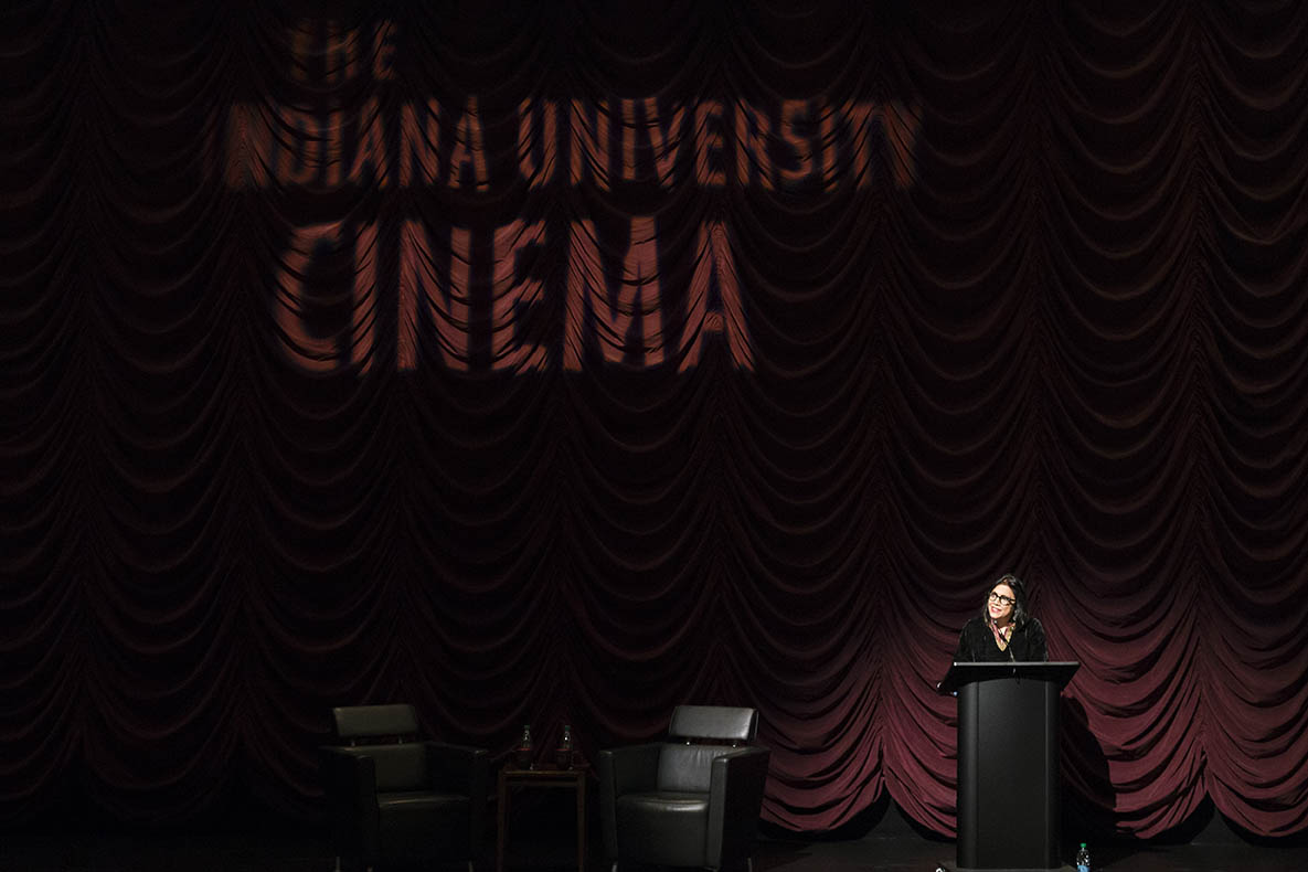 Mira Nair at the podium during her Jorgensen lecture at IU Cinema.