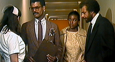Still image of two couples in a hallway from the film Personal Problems