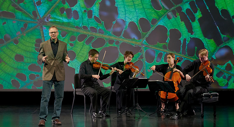 Still image of musicians playing from the program Rising Tide: The Crossroads Project.