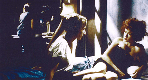 Still image of two women on a bed from the film Sleepwalk