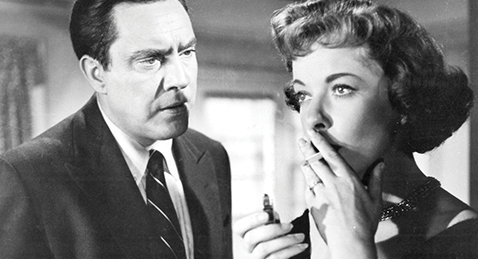 Still image of a man with a women lighting a cigarette from the film The Bigamist.