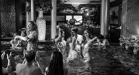 Still image of a people having a party in a pool from the film The great Buddha+.