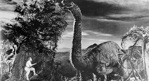Still image of a man and a dinosaur from the film The Lost World.