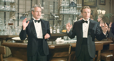 Still image of two men at a bar with there hands up from the film The Sting.