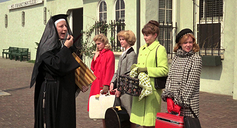 Still image of a four women and a nun on the street from the film The Trouble with Angels.