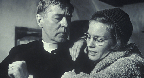 Still image of a man and a women from the film Winter Light.