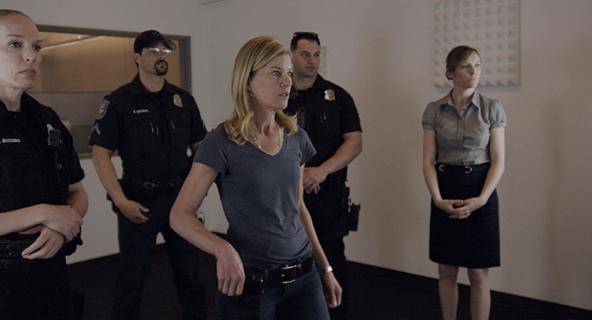 a group of law enforcement offices stand in a room from the film bias