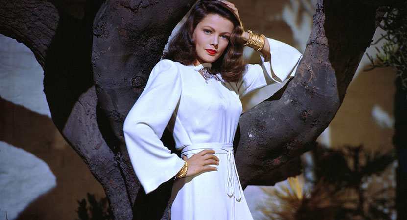 a women poses in a white dress from the film Leave her to Heaven