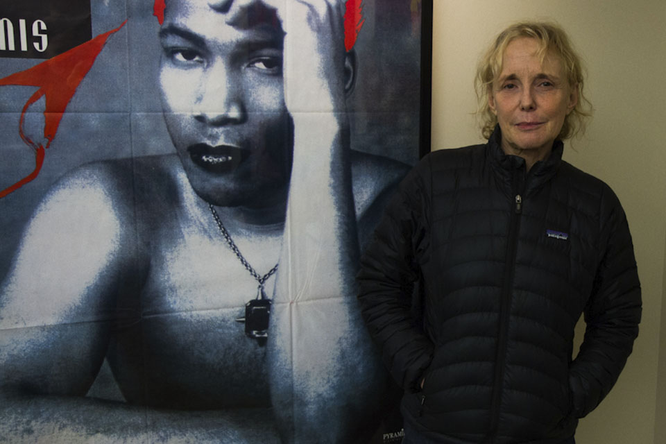 Claire Denis poses with a poster to one of her films outside of the Black Film Center/Archive