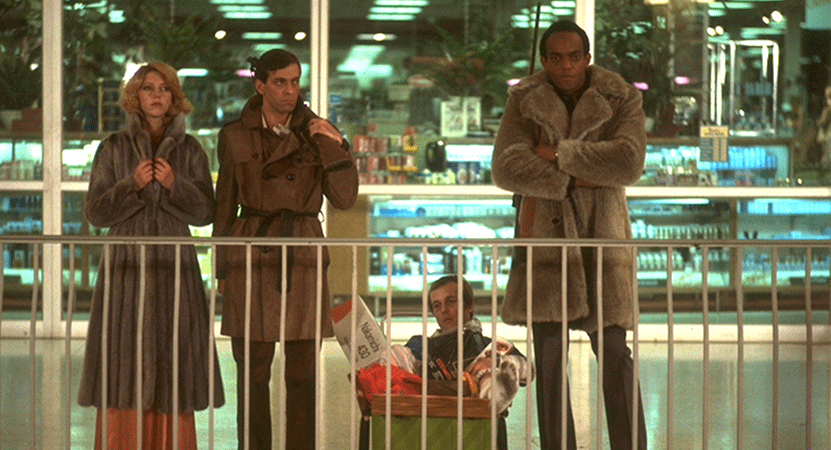 A group of people stand in a mall from the film Dawn of the Dead