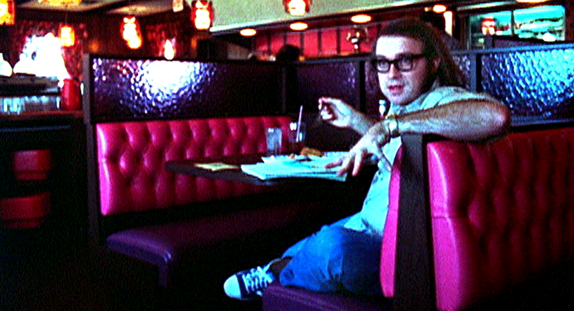 a man sits in a dinner booth from the film Demon Lover Diary.