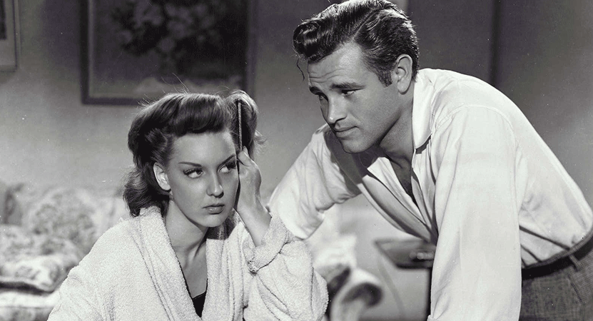 a man stairs at a women while she does her hair from the film Detour.
