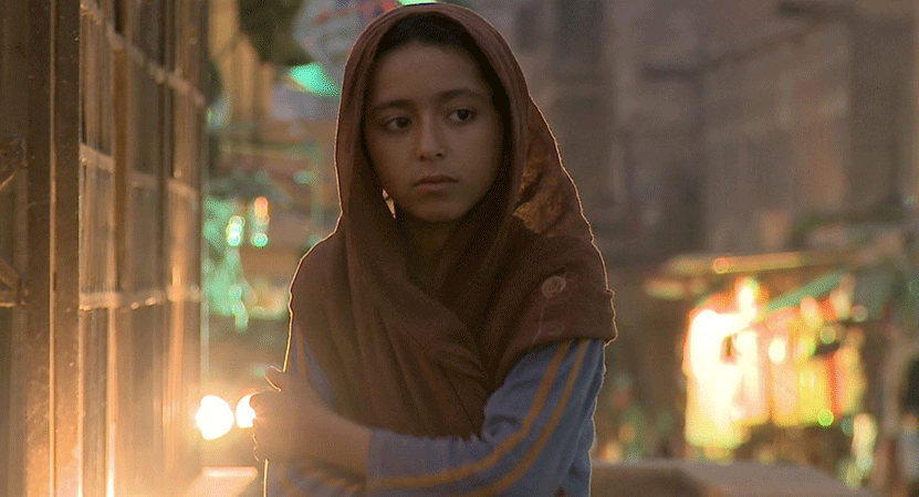 a girl stands in the street from the film The Dream of Shahrazad