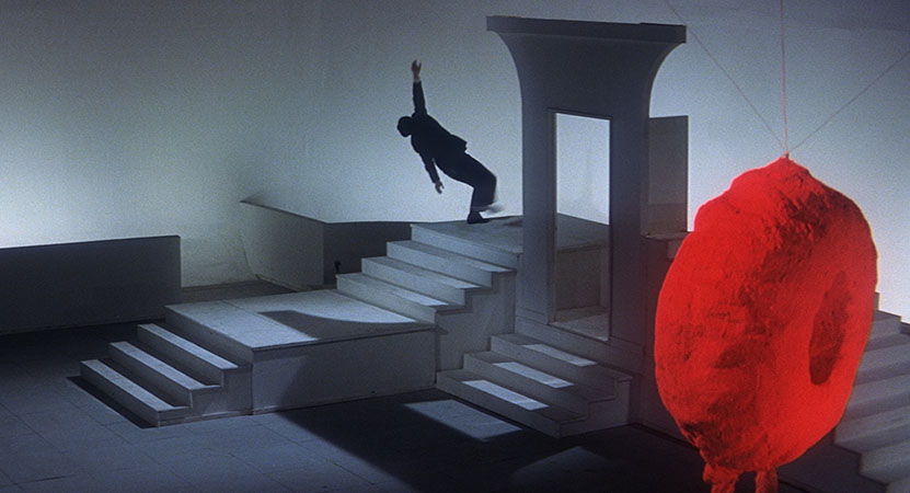 a person dances on stairs from the film Tokyo Nagaremono (Tokyo Drifter)