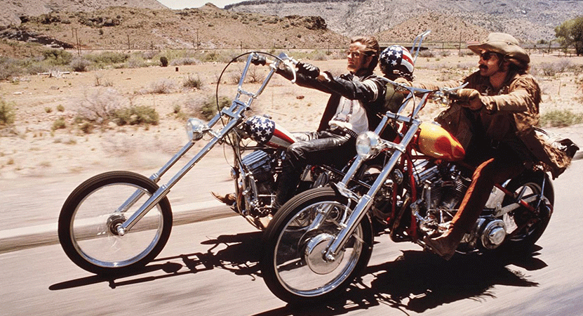 two men ride motorcycles from the film Easy Rider.