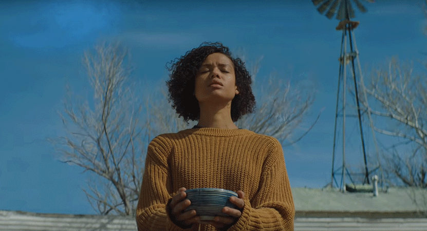A women stand outside holding a bowl from the film Fast Color