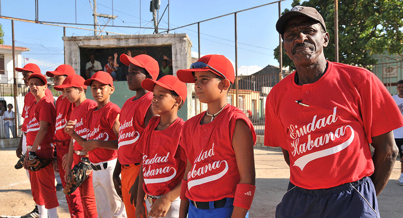 A youth baseball team lined up on the field from the film Ghost Town to Havana.