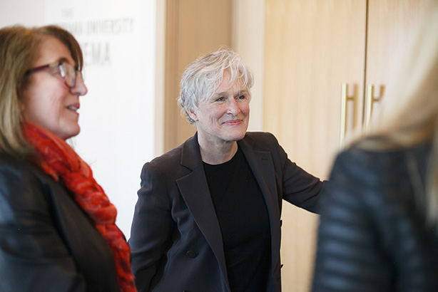 Glenn Close talks with guest in the lobby of IU Cinema.