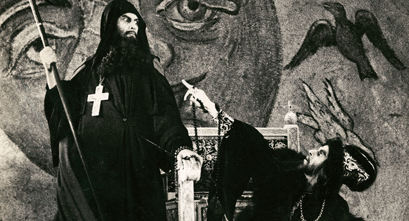 a priest looks down on another man from the film Ivan the Terrible, Part I