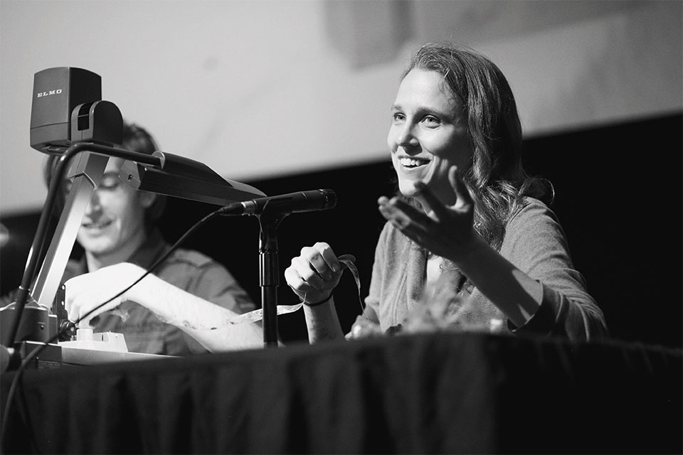 Josephine Decker addresses the audience  while Russell Sheaffer works on film during a Jorgensen Guest filmmaker event.