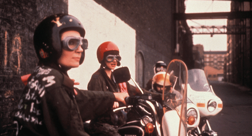 a woman sits on a motorcycle from the film Jubilee