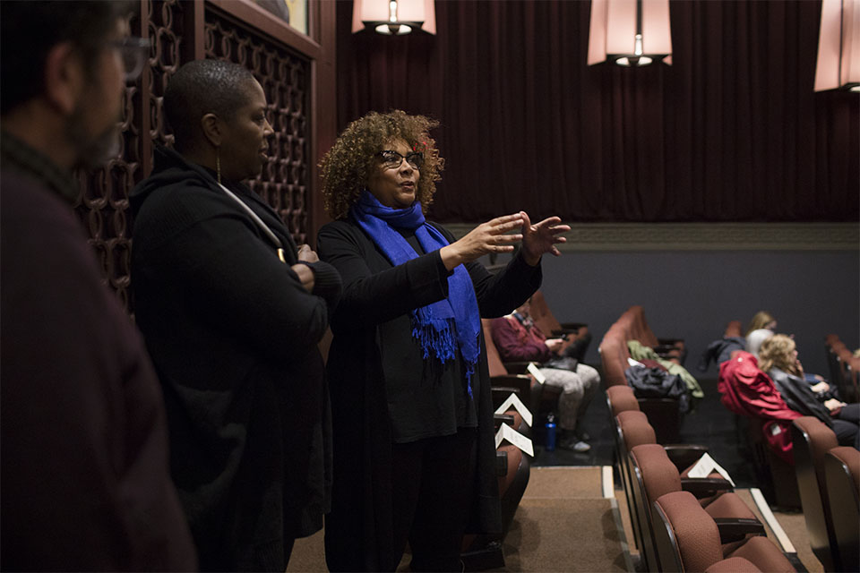 Julie Dash talks to a group of guest at the back of the IU Cinema.