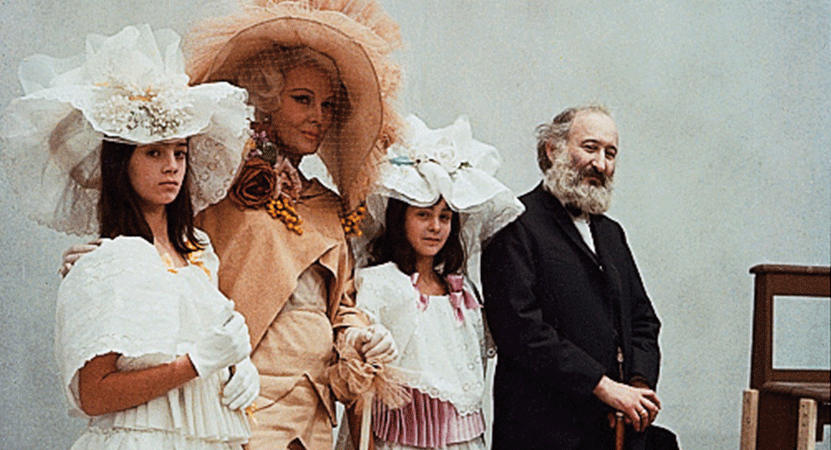Three women in fancy hats and a man stand together from the film Juliet of the Spirits.
