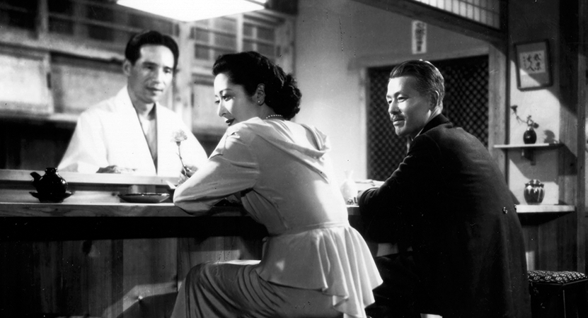 a man and women sit at a restaurant bar from the film Late Spring