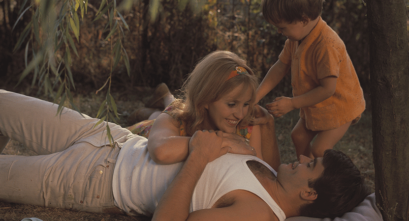 a family spend time together outdoors from the film Le bonheur