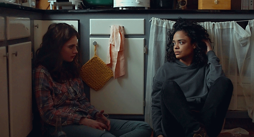 two women sit on the floor of a kitchen from the film Little Woods.