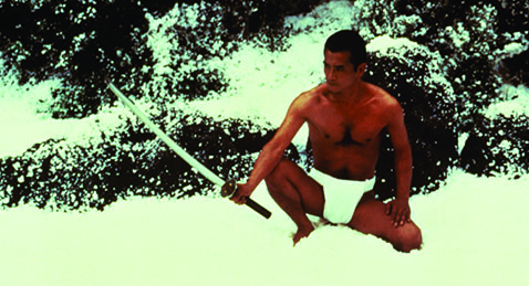 man in the snow with a katana sword from the film Mishima: A Life in Four Chapters.