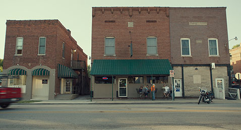still image of downtown storefronts from the film Monrovia, Indiana.